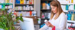 pharmacist looking at prescription